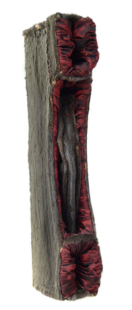 Gift (2004), size: 77 x 14 x 27cm. Wood, furskin, changeant.