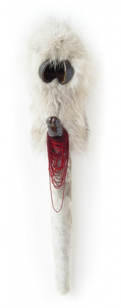 Transgression (2002), size: 85 x 20 x 18cm. Furskin, beads, clay, paint, fruit.