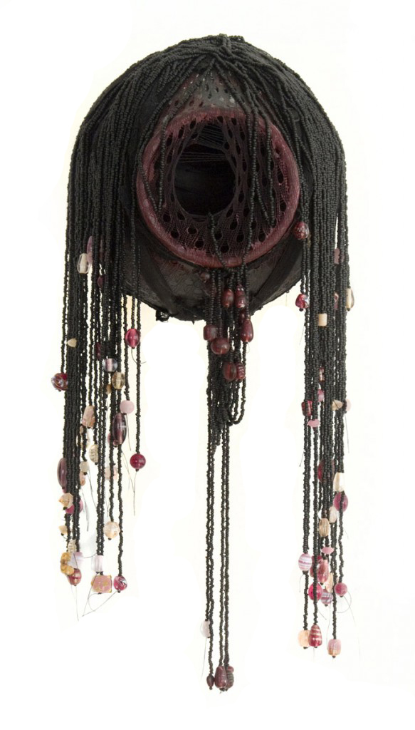 Sleazy (2010), size: 40 x 20 x 18cm. Pottery, beads, paint.