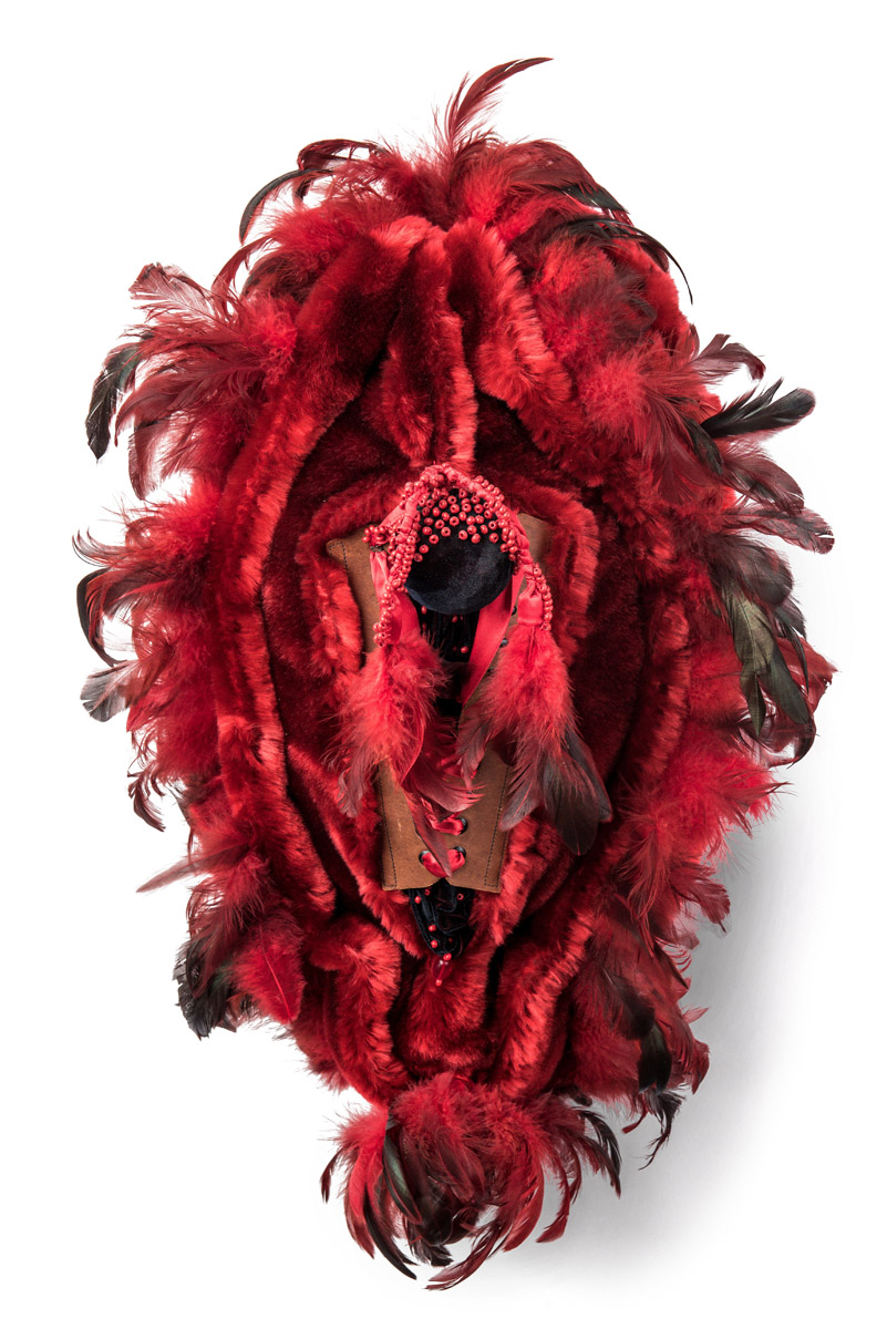 Keep the fire burning! (2017), 60x40x20cm. Fake fur, feathers, beads, leather.