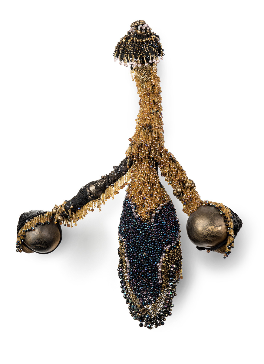 Power (2018), 70x55x12cm. Beads, bells, kalebash, lace.