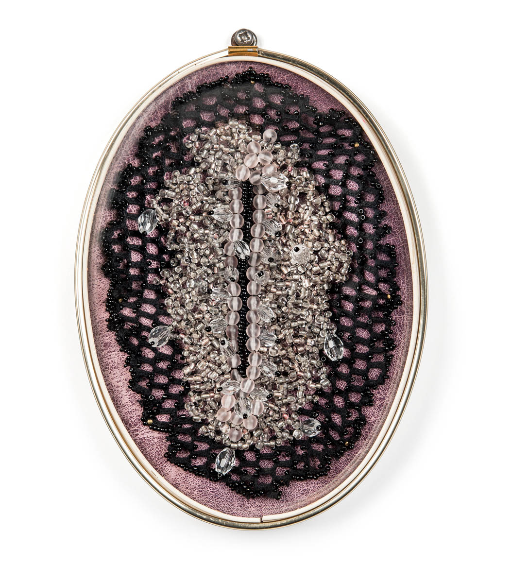 Punani (2017), 20x14x4cm. Beads, lace, leather, glass, frame.
