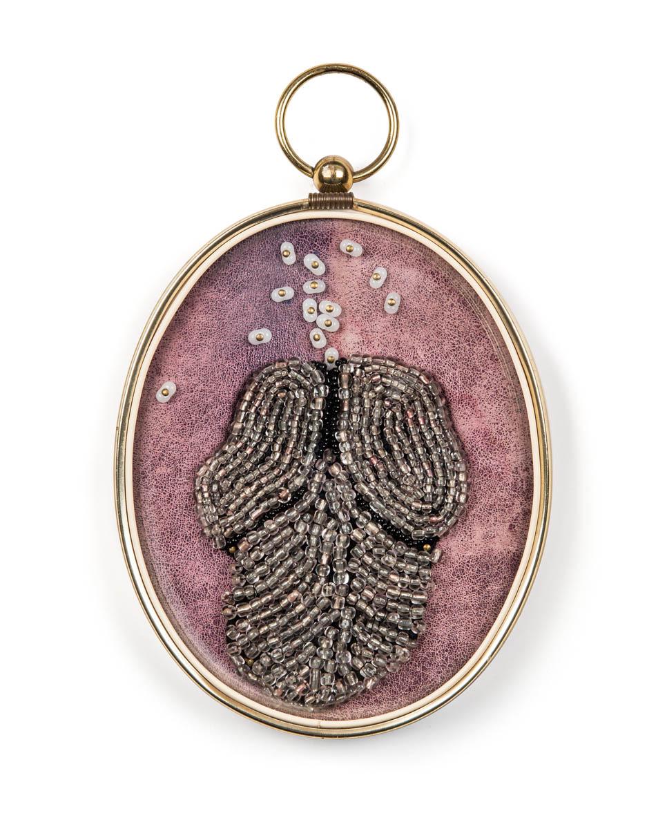 Toreador (2017), 18x12x4cm. Beads, leather, glass, frame.