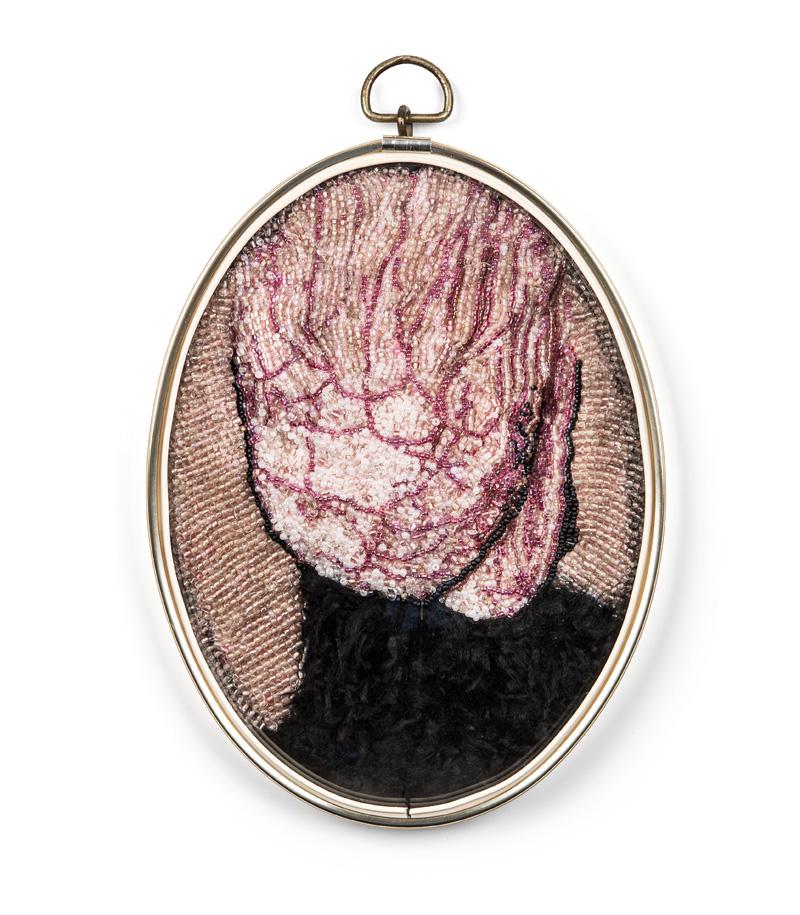 Trophy (2018), 20x17x4cm. Beads, fake fur, glass, frame.