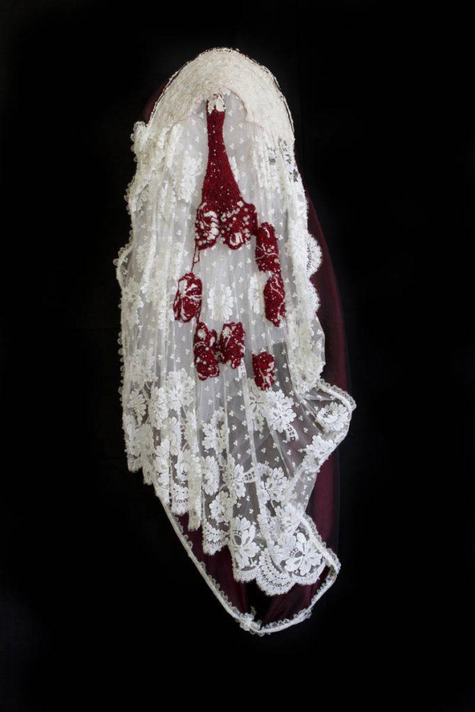 Catholic triptych 2: bride (2013), size: 120 x 4 x 21cm. Lace, textile, beads, metal.
